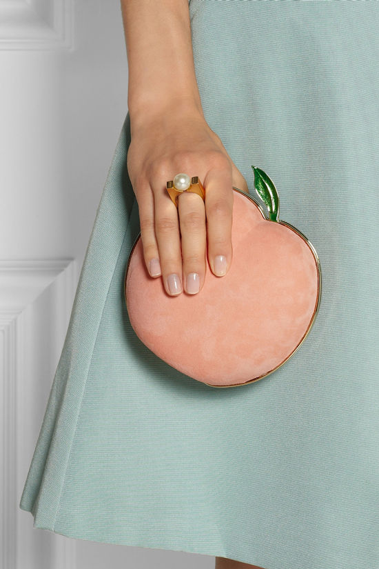 Charlotte-Olympia-What-A-Peach-suede-clutch-closeup-hand